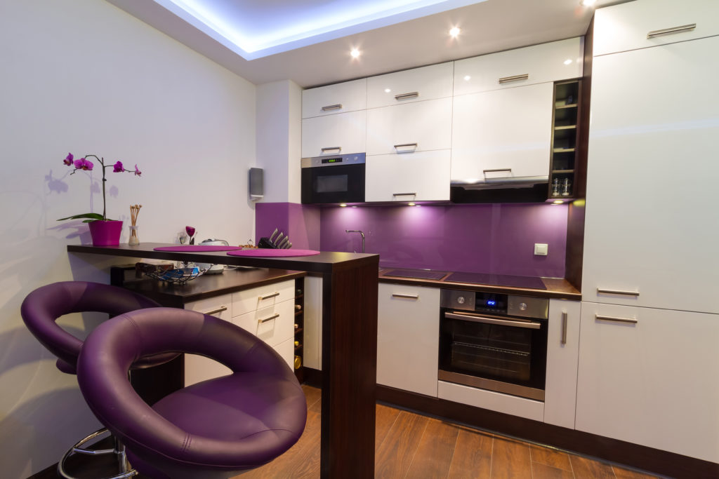 Deep purple accent wall in a modern kitchen