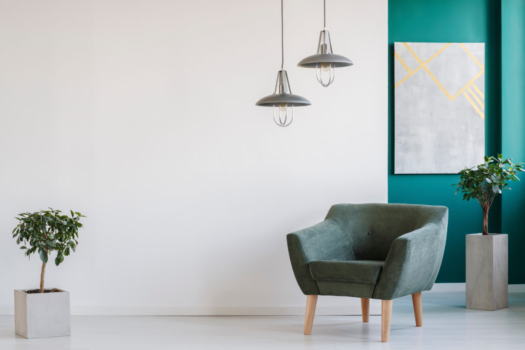 Teal accent wall highlights this modern and minimalistic feel