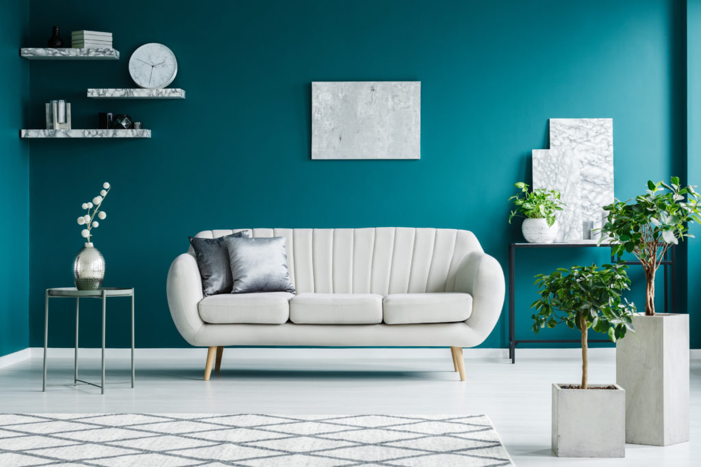 Modern and clean teal colored living room