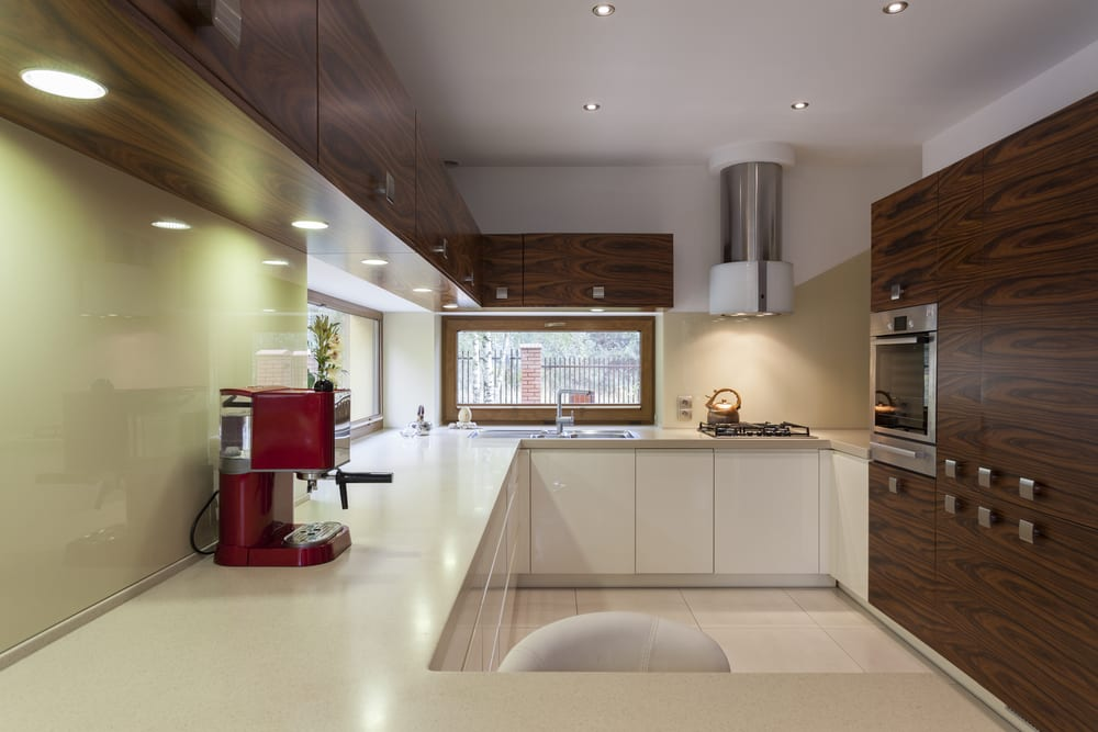 Pale green walls in a small, modern kitchen