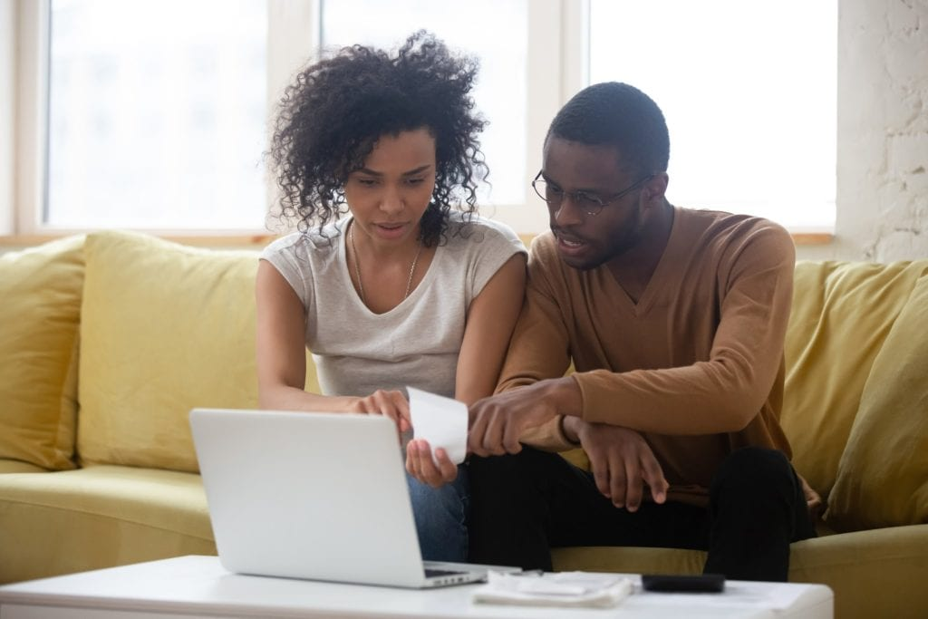 A young couple considers refinancing their mortgage