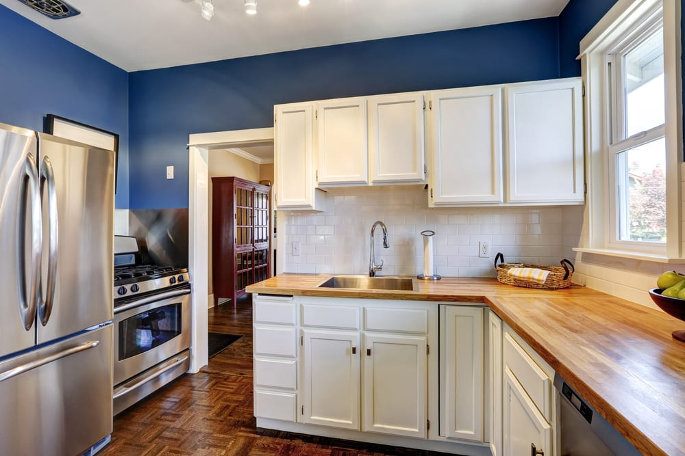 Navy blue kitchen with white walls