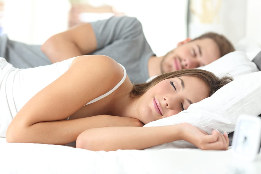 couple sleeping on bed