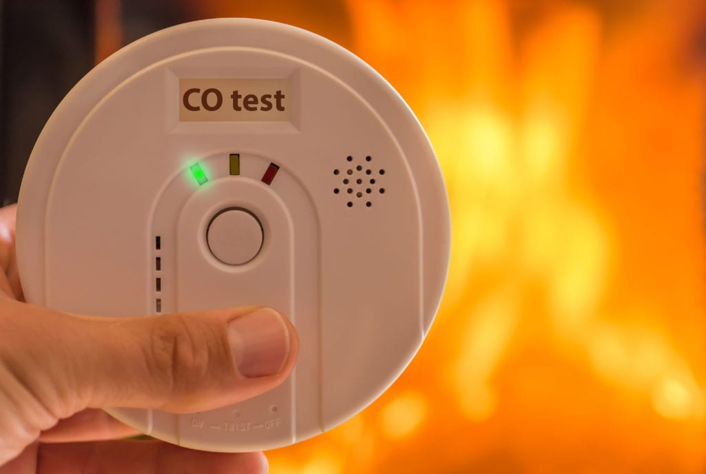 Carbon monoxide alarm in room heated by fireplace