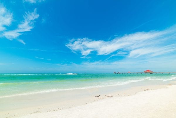 White sand beach and clear blue sky in Clearwater, FL