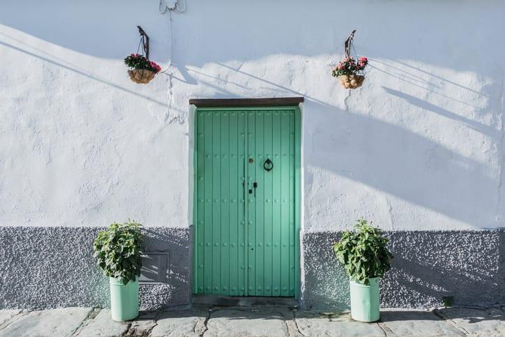 seafoam green door in Sevilla, Spain