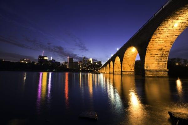 stone arch bridge in Minneapolis Minnesota cityscape