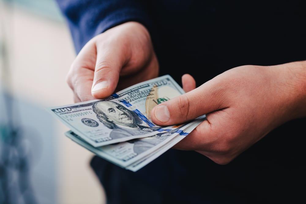 Man holding cash of security deposit
