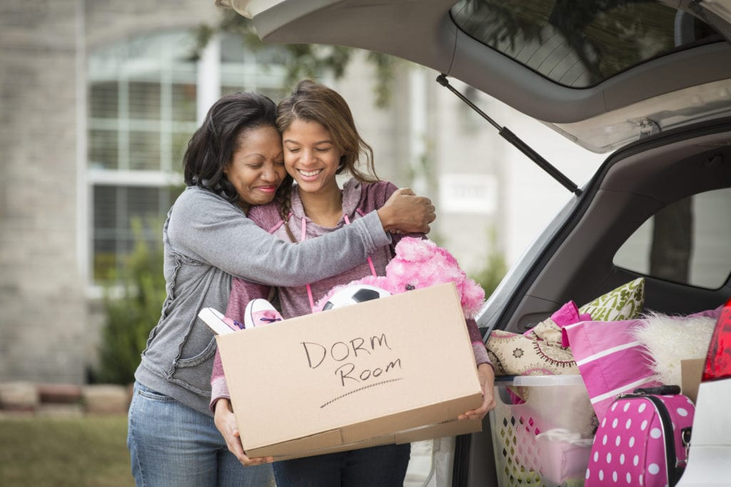Mother hugging daughter going off to college