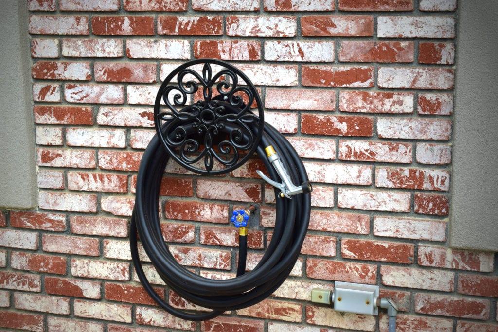 Black hose with decorative hose holder