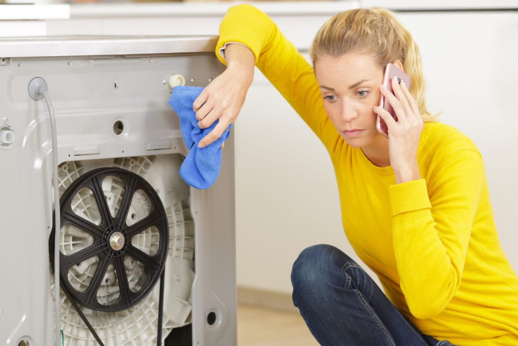 Woman calling plumber to repair a leak
