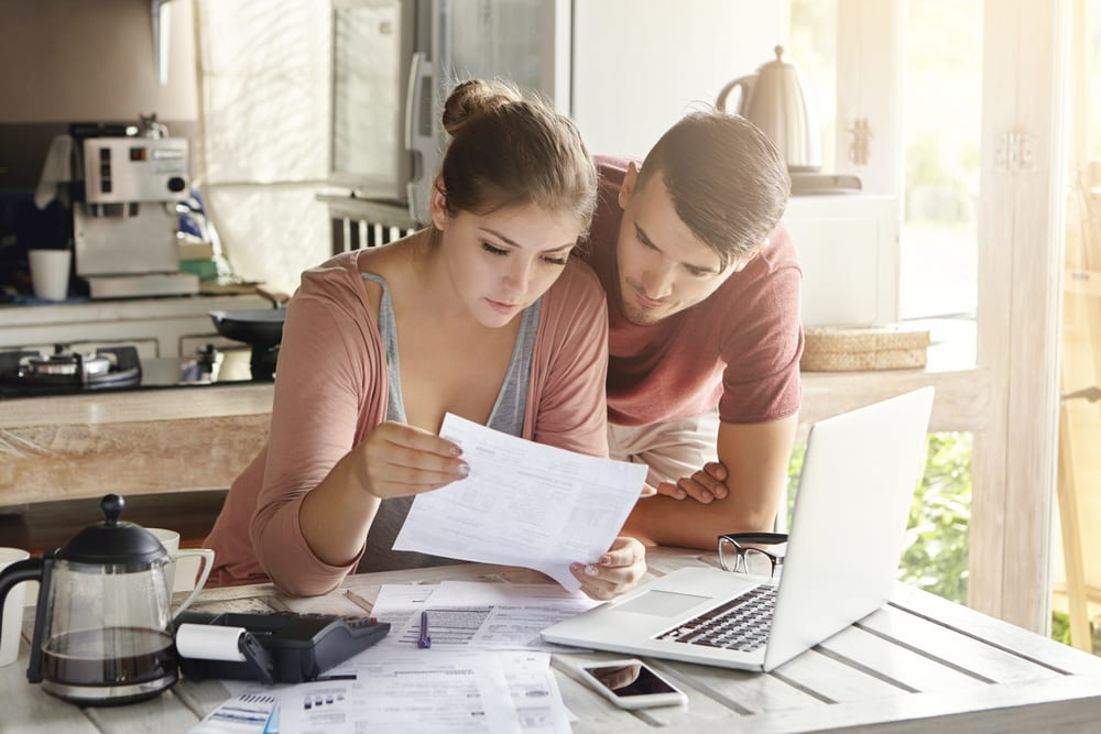 Young couple paying rent
