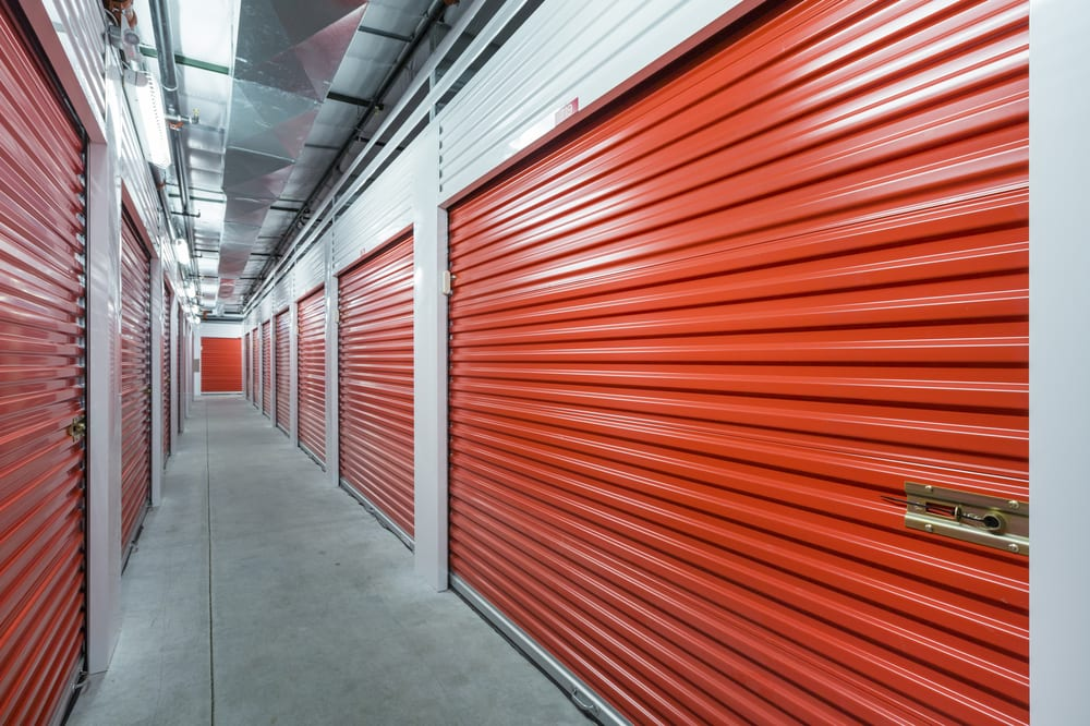 Inside of a storage facility with red pull-down doors