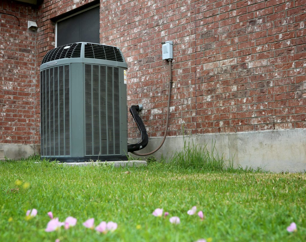 Carrier HVAC unit outside on green lawn