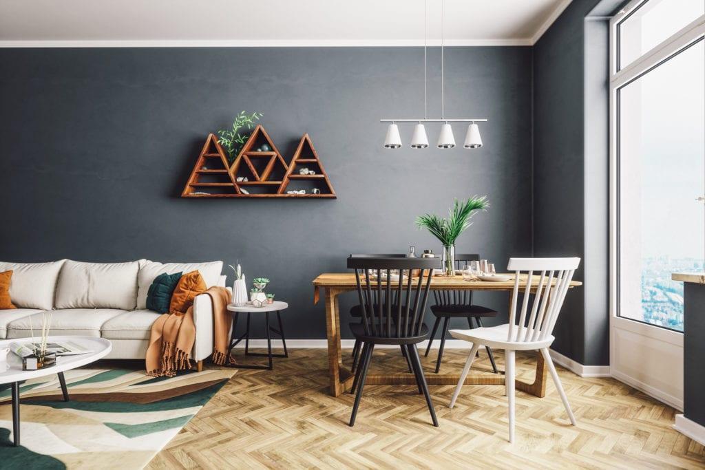 triangular decor shelf on black wall