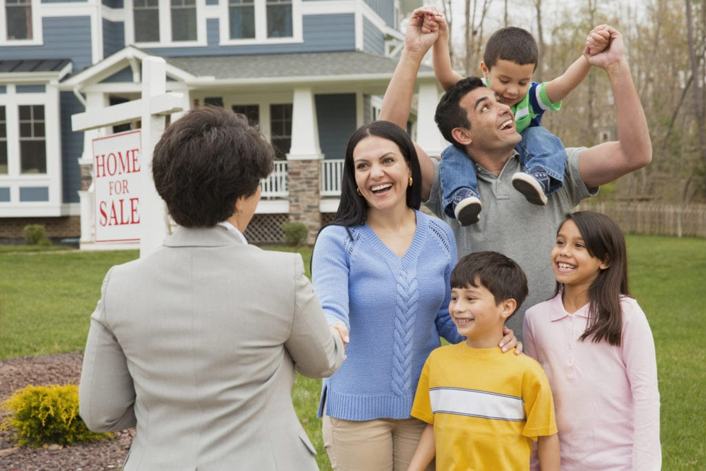 Realtor welcomes a young family into their new home