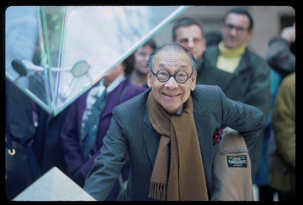 Architect I.M. Pei stands beside the tip of the Louvre's inverted pyramid in the Galleries of the Carrousel. He designed the glass and metal pyramids to serve as an entrance to the Louvre museum. (Photo by Owen Franken/Corbis via Getty Images)