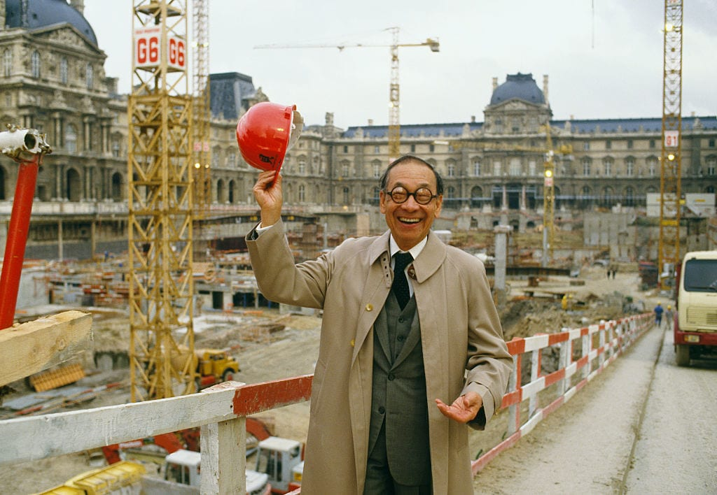 I.M. Pei, the architect of the Louvre's glass Pyramid Entrance, stands at the entrance's construction site. (Photo by THIERRY ORBAN/Sygma via Getty Images)