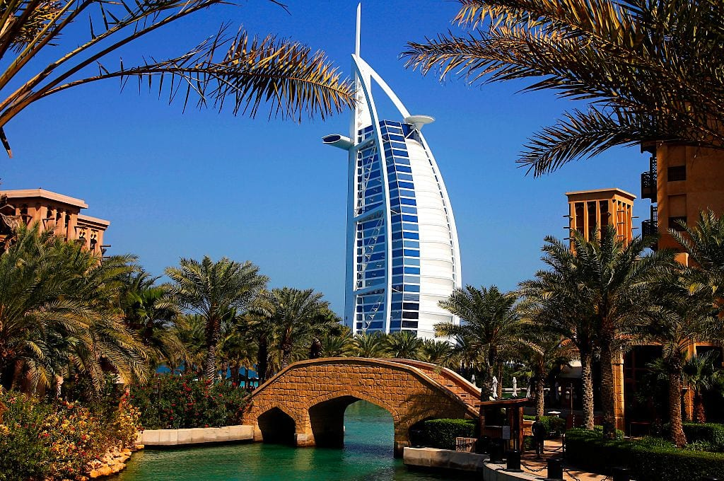 Dubai, United Arab Emirates (2013): Burj al-Arab (Tower of the Arabs) luxury hotel, self-proclaimed 7-star hotel. 321 metres high, it was the tallest hotel in the world until 2007. It was designed in 1993 by architect Tom Wright. It stands in the Persian Gulf, on an articifial island, and the shape of the structure is designed to mimic the sail of a ship. (Photo by: Andia/Universal Images Group via Getty Images)