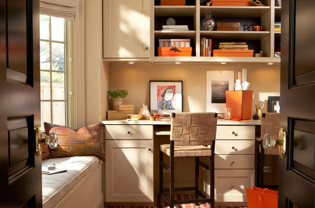 Modern home office with orange accents