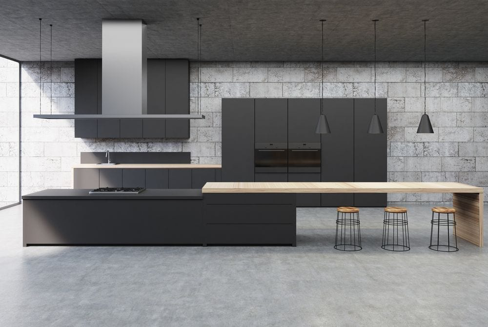 Concrete floors go well in industrial kitchens. ImageFlow/Shutterstock