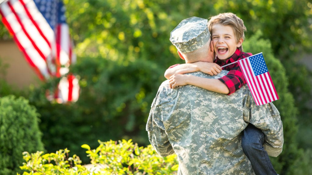 Soldier reunites with his son, hugging