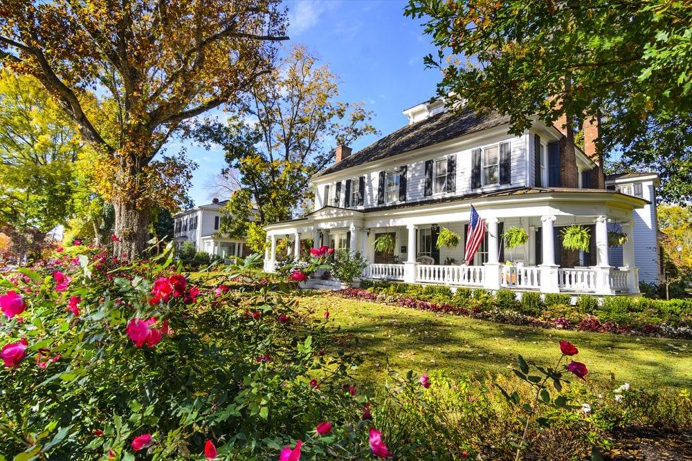 Older home have lush landscaping.