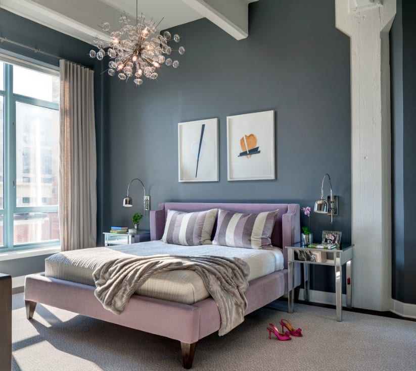 bedroom grey walls side tables bedding