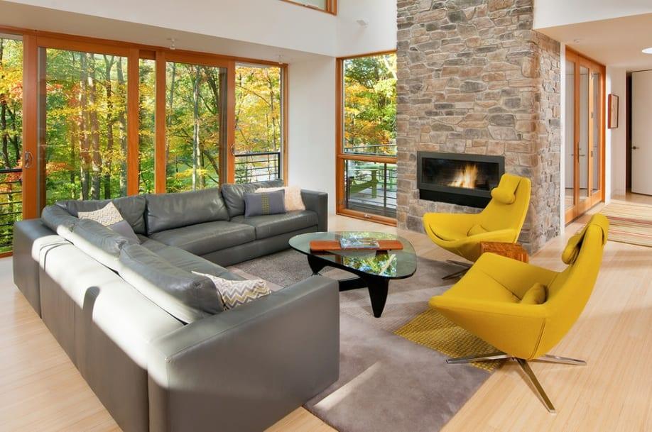 brick fireplace yellow modern chairs