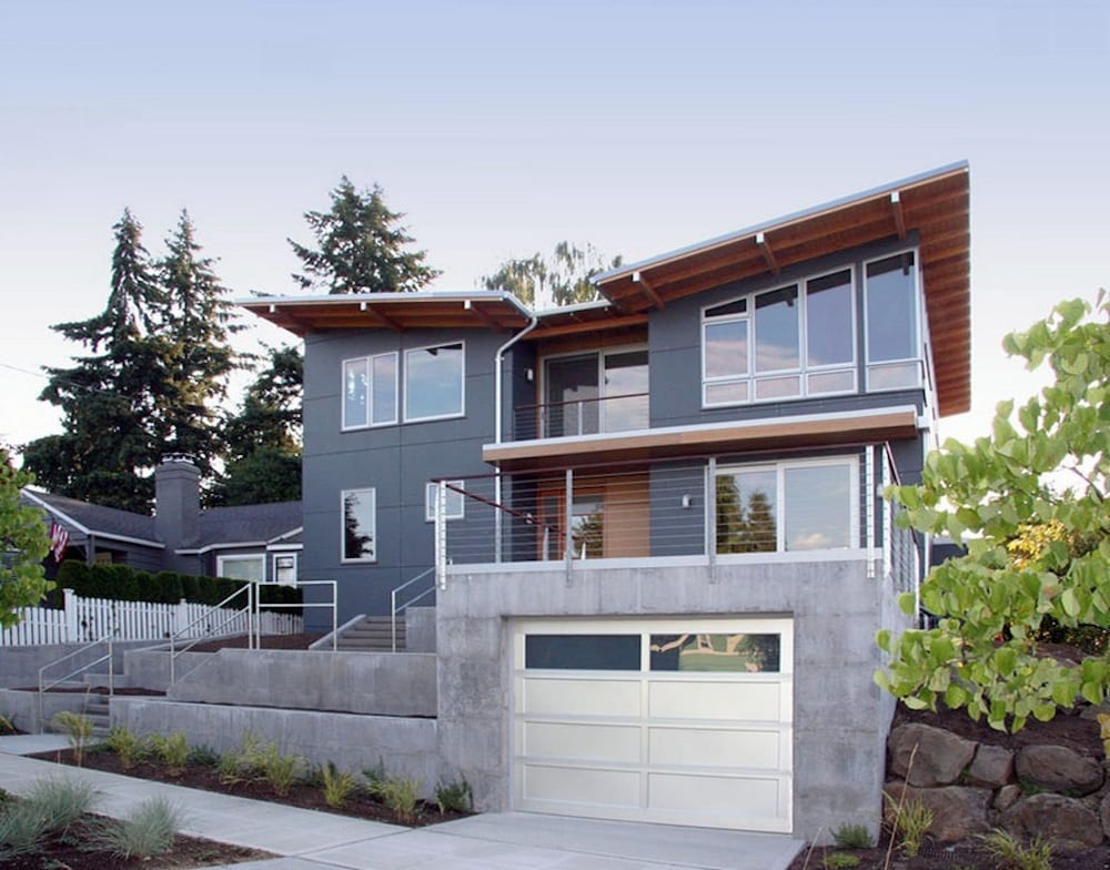 Clean your gutters in the spring and fall for peak water flow. Image Via: Neiman Taber Architects