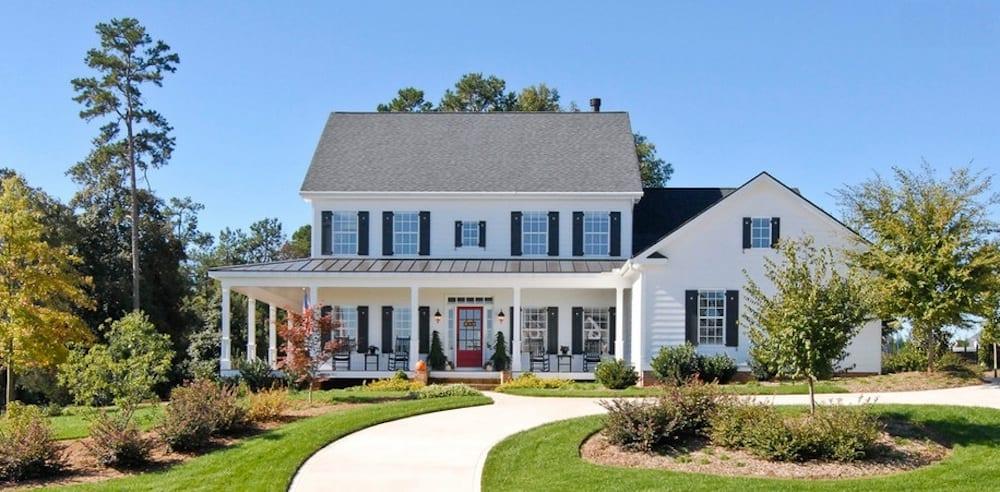 Consider buying extra shingles to make replacing broken ones even easier. Image Via: Bergeron Custom Homes, LLC