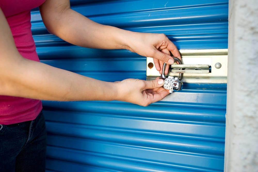 Woman unlocks her storage unit