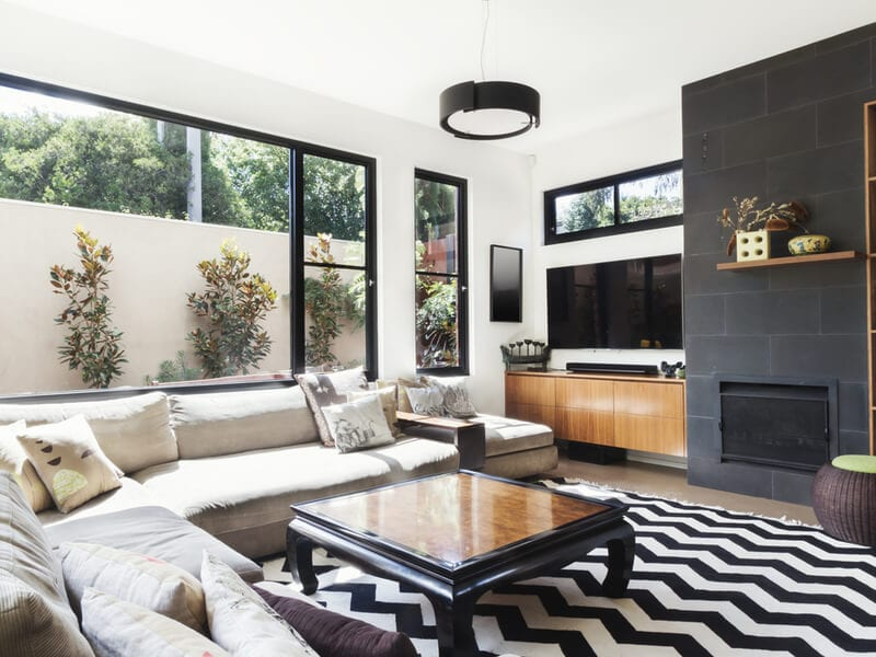 Monochromatic living room with large TV