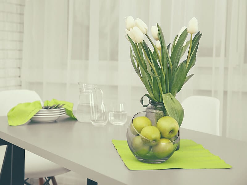 Kitchen table with green apples and decor