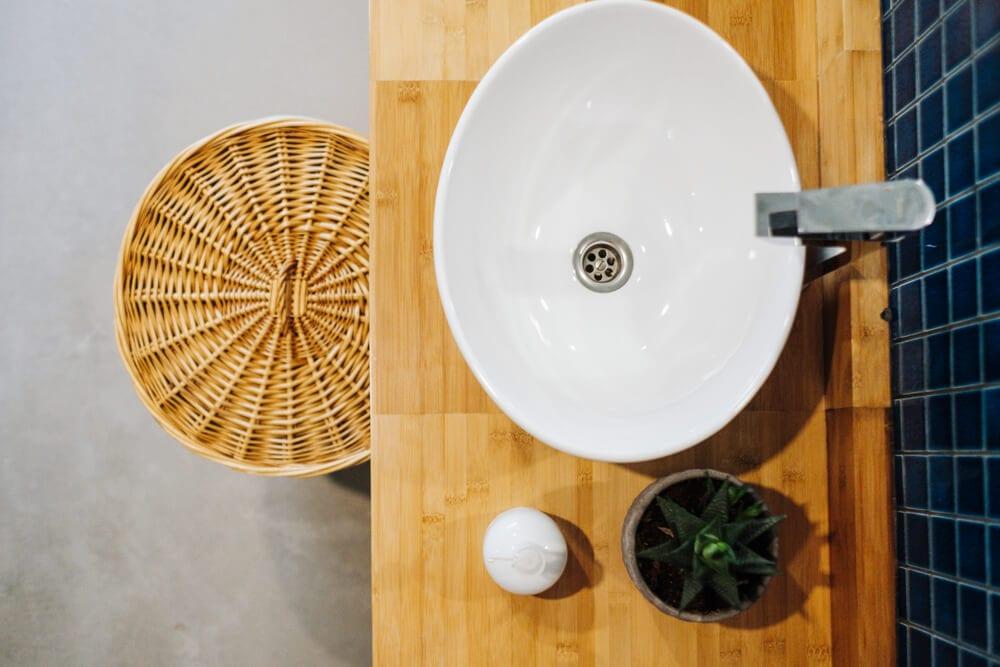 Hamper for storage under sink in small bathroom