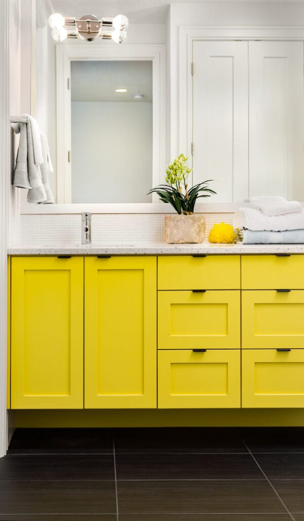 Bathroom with yellow cabinets for accent
