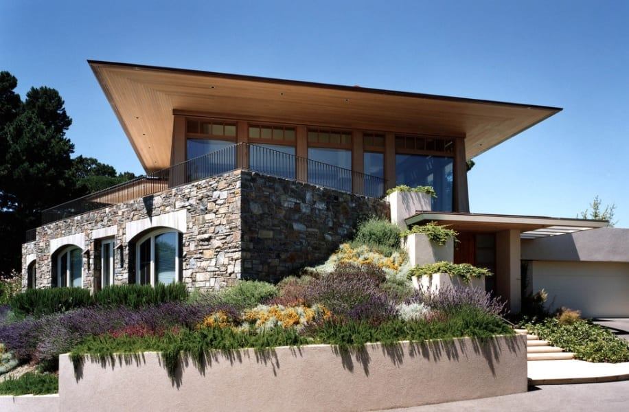stone and wood modern home roof