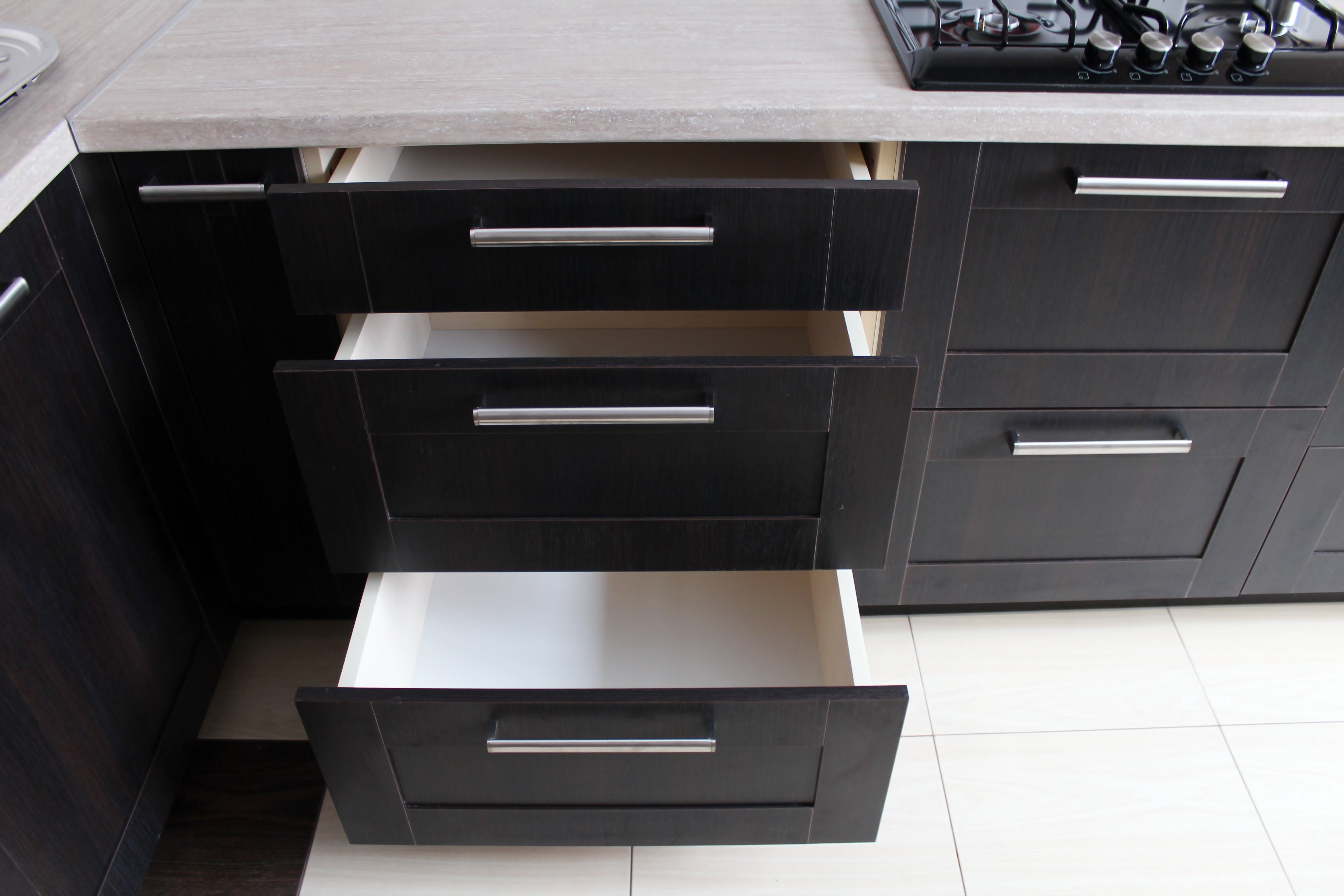 Black kitchen cabinets with open drawer