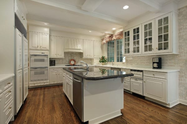 Luxury kitchen with island and cream colored cabinets