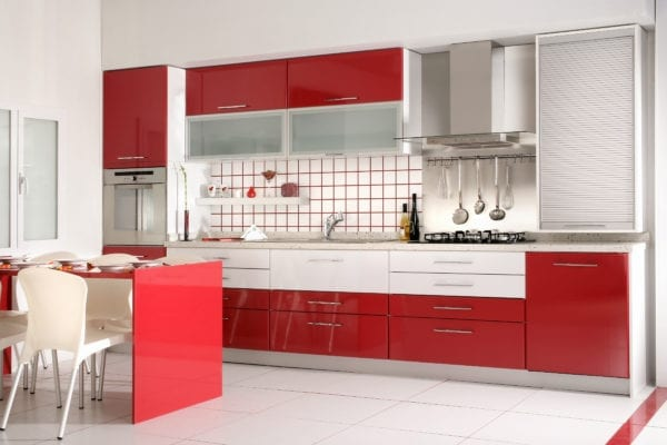 Kitchen with red cabinets and accents