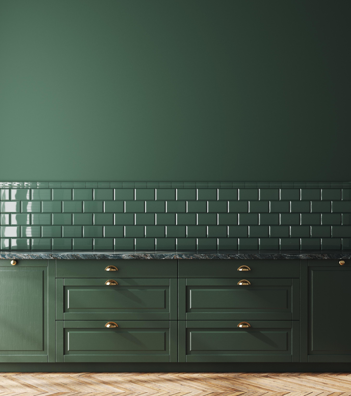 Dark green monochromatic kitchen