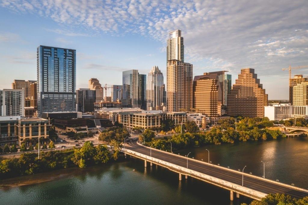 Aerial shot of Austin, TX skyline during a summer golden hour.