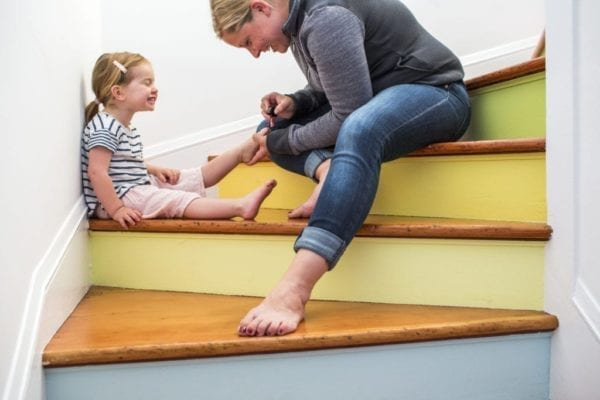 Mother and daughter on painted staircase