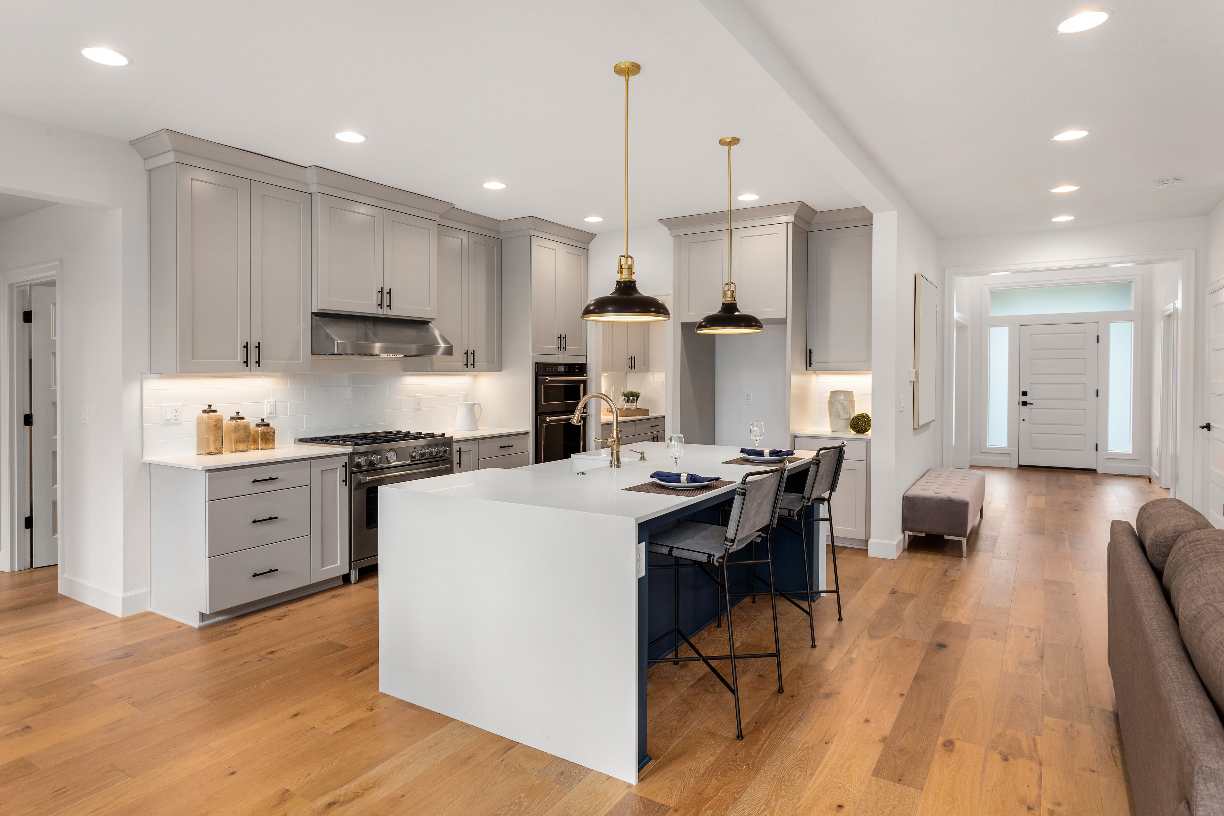 Luxury kitchen with hardwood floors and greige cabinets