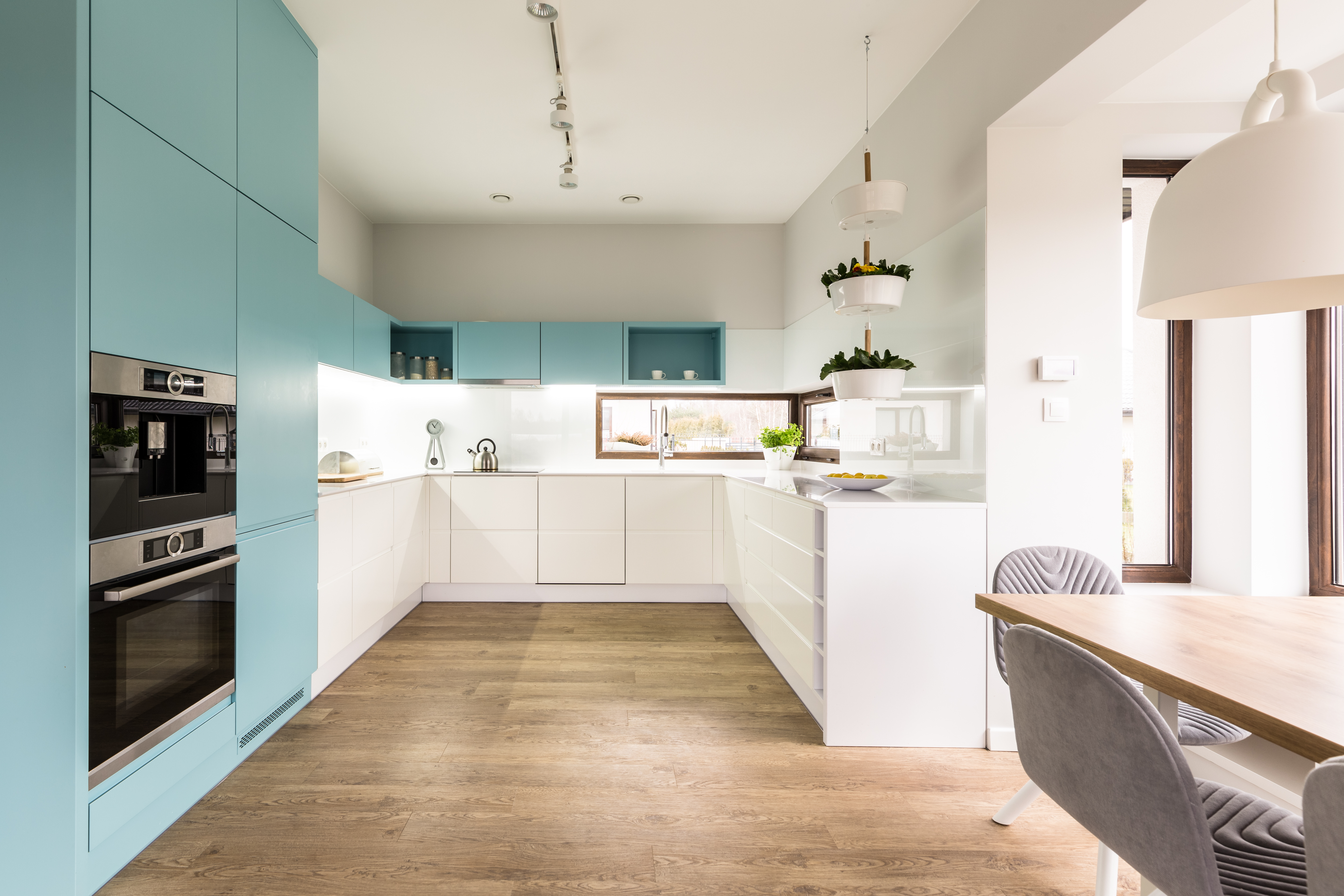 Kitchen with white and blue cabinets