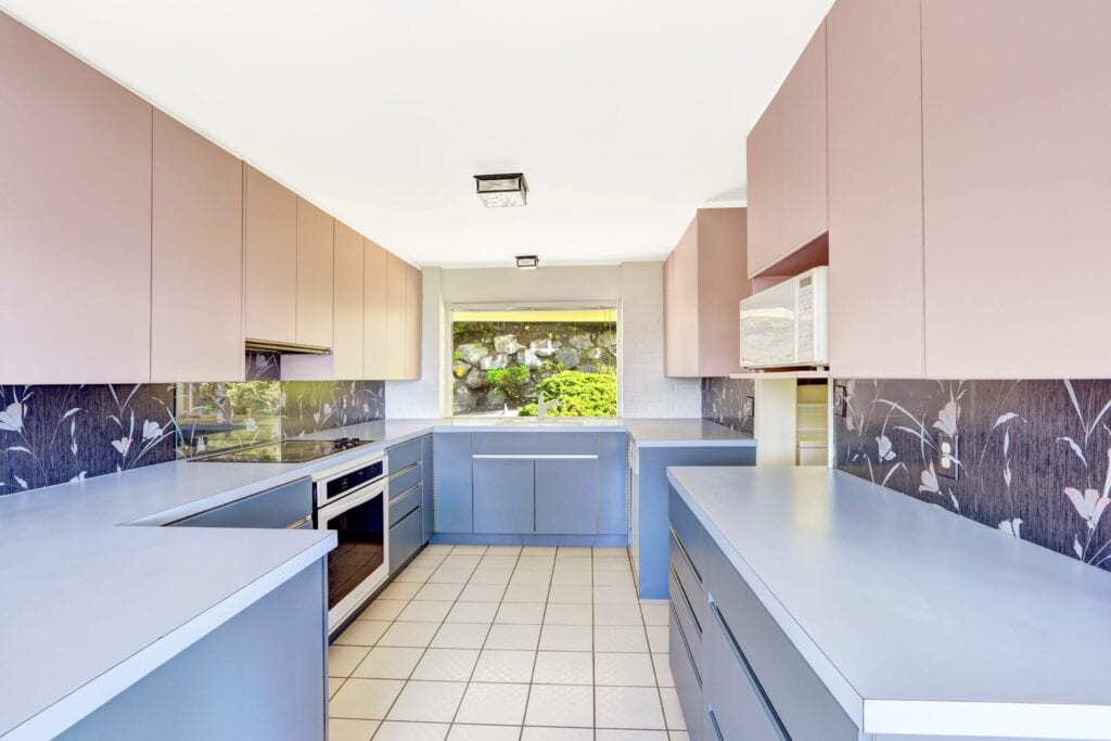 Kitchen with tile floor and pink and blue cabinets