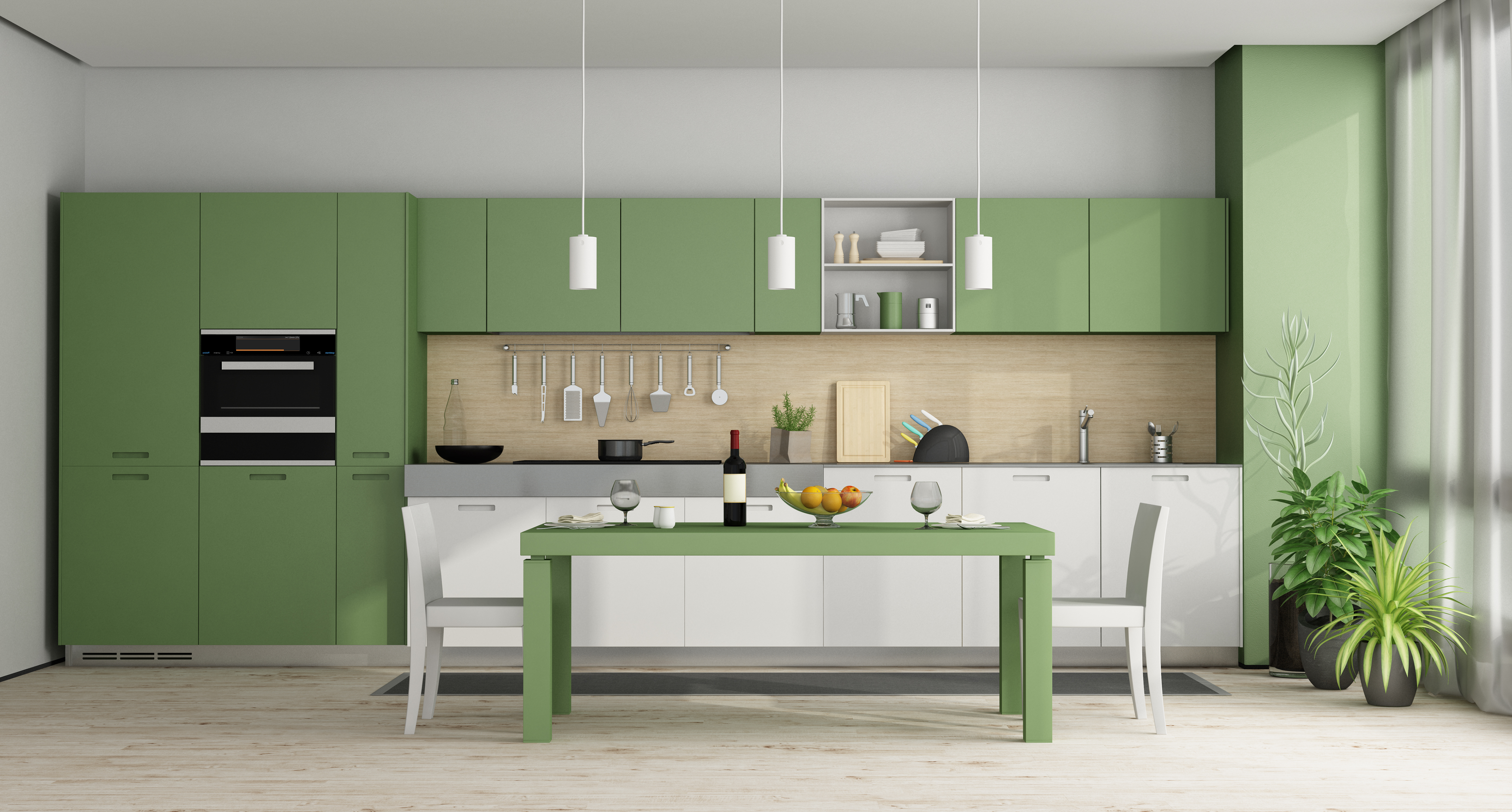 Modern kitchen with green cabinets and dining table