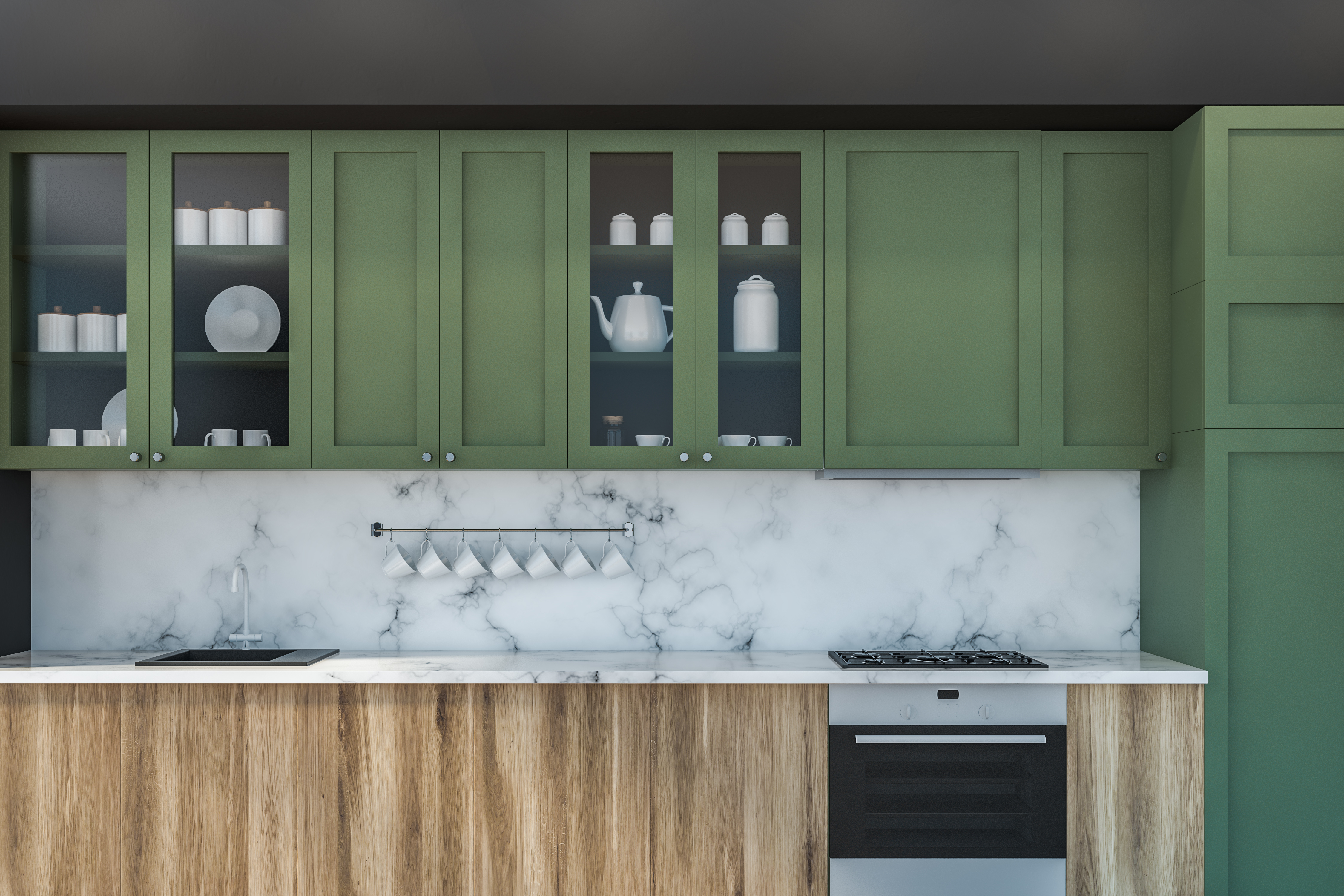 Kitchen with sage green cabinets and wooden island