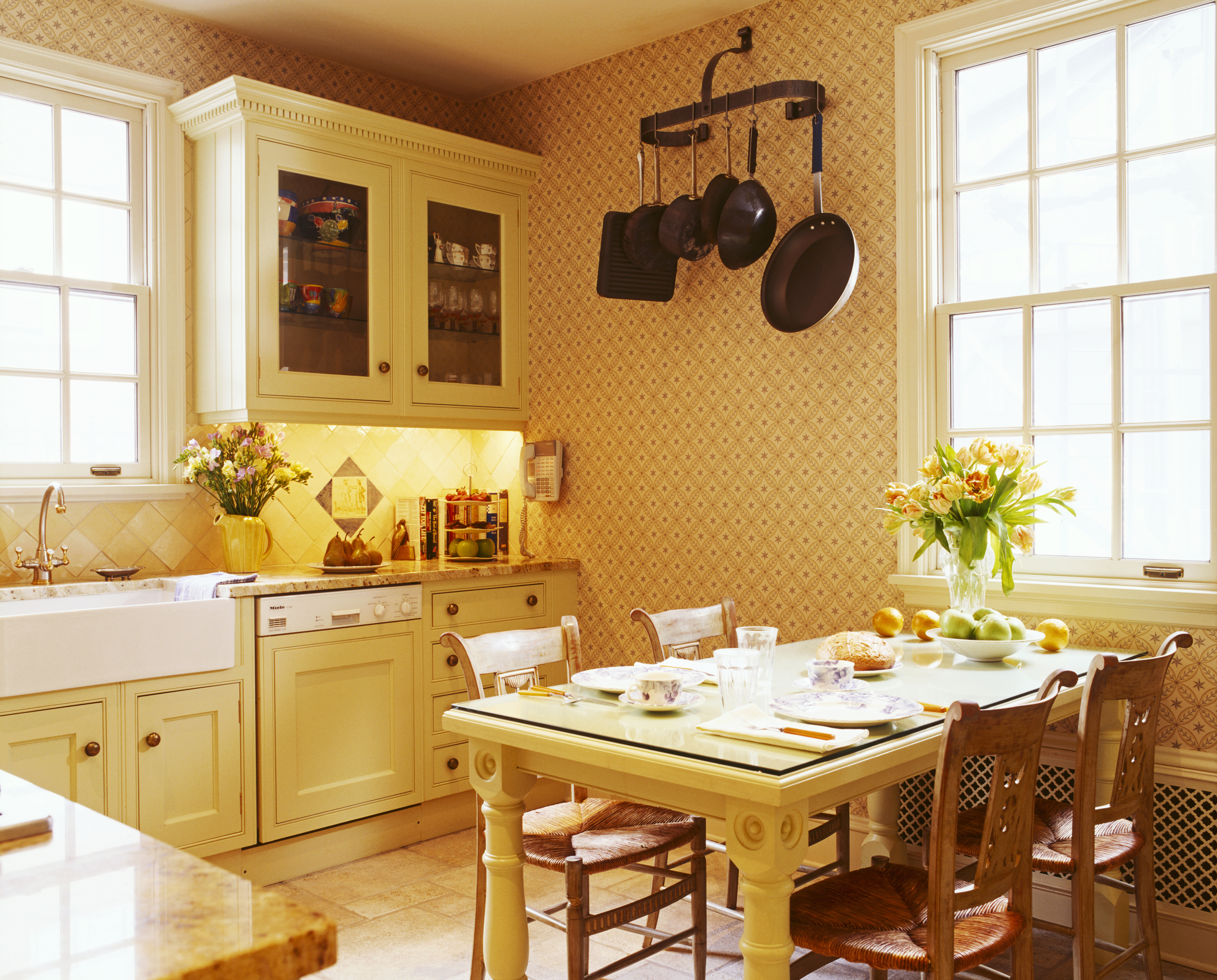 Yellow kitchen with yellow cabinets and table