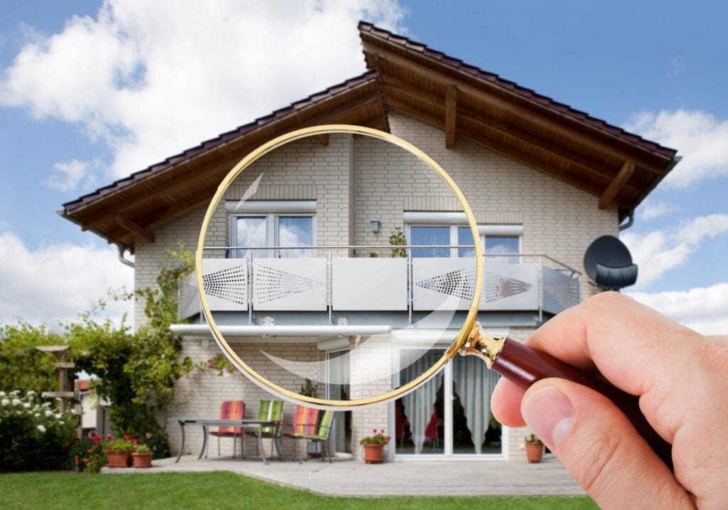 magnifying glass over luxury home